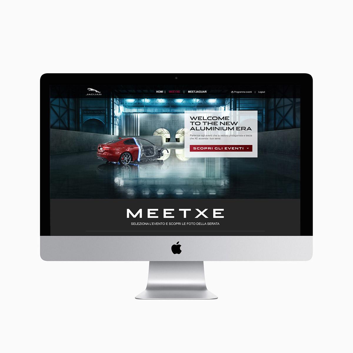 Monitor iMac con pagina Meet XE dedicata agli eventi per la Jaguar XE